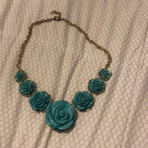 Francescas gold necklace with teal flowers